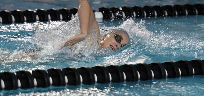 Senior, Maddy Wagner swims toward victory in the 200 Freestyle